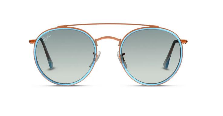 DIE Sonnenbrille für Salzburg: Rundes Doppelstegmodell von Ray-Ban mit auffälligem Farbmix.